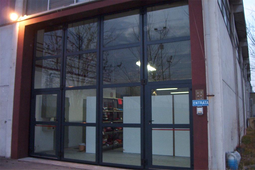 Folding Industrial Doors Glass Door Ii Isotek Engineering Srl